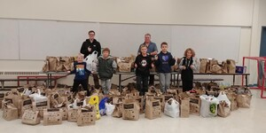 Students pose with food donations during Drive Away Hunger.